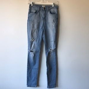 Sneak Peek High Rise Light Wash Distressed Jeans